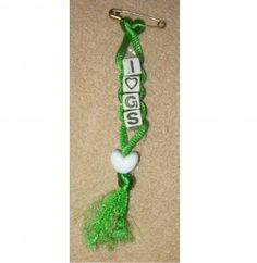 Girl Scout swap is made with craft cord, letter beads, and a pony bead.