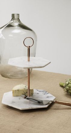 Marble is having a moment and paired with warm metallic copper, our handcrafted Double Tiered Marble Cake Stand with its angular lines and unusual hexagonal shape makes a sophisticated addition to your tableware collection.