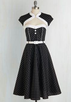 Soda Shop Sweetie Dress in Black. A vanilla milkshake with two straws, please, you order, your white-dotted dress matching the retro decor of the parlor. #black #modcloth