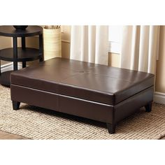This sleek and modern leather storage ottoman is covered in an elegant brown leather upholstery and features a dark brown finish. The long design and flip-top storage provide ample room for hiding your favorite blankets or sitting in style.
