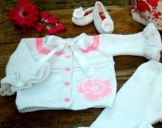 Vest for little ladies 6-12 months. Hand Embroidered and decoration delicate flowers. Total length - 30 =11 3/4 width of chest -25 cm - 9 7/8   Used is baby acrylic yarn/made with soft yarn to be comfortable for any precious little one/ and 5 beautiful buttons. Hand knitted with love and care for your baby :)  Hand wash recommended / Flat dry / No ironing  Shipping: via Bg post -Airmail (registered mail).