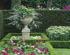 Plant flowers in the center of shrubs and add height for a focal point