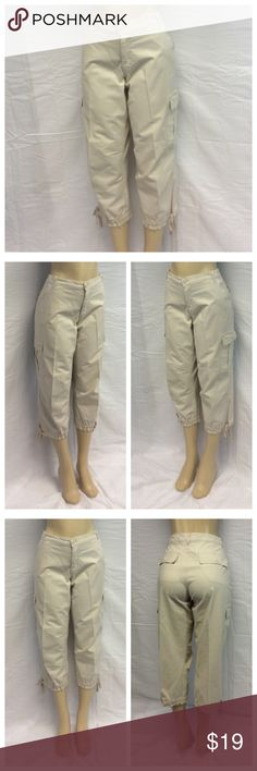 """DUPLEX LADIES CROPPED PANTS DUPLEX LADIES CROPPED PANTS, ties on bottom legs, Size 14, 97% cotton, 3% spandex, machine wash. Approximate measurements are 18 1/2"""" waist laying flat, 32"""" waist to hem, 22 1/2"""" inseam, 10"""" waist to crotch, 5"""" zipper. 0421 Duplex Pants Ankle & Cropped"""
