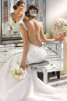 This decadent beaded fit and flare lace wedding dress is so sexy and beautiful. Essense Of Australia, Spring 2014