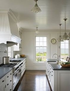In this pic i love the ceiling boards and the window that elongates the space further