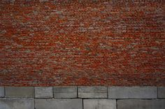 red brick wall with concrete blocks background