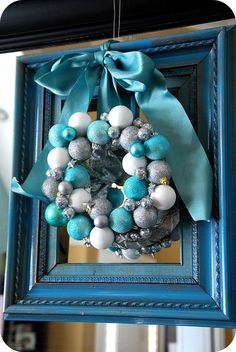 lot like Christmas -- My Blue and Silver Christmas Mantel! Frame a wreath--This is so pretty, but I would rather have more traditional colors or silver.Frame a wreath--This is so pretty, but I would rather have more traditional colors or silver. Turquoise Christmas, White Christmas Trees, Silver Christmas Decorations, Christmas Frames, Christmas Mantels, Winter Christmas, Christmas Holidays, Holiday Fun, Christmas Ideas