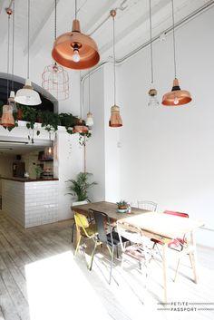 industrial copper lighting. pendant lights. White subway tile for kitchen island