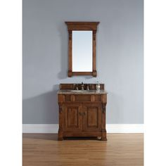 Enhance your bathroom with this vanity with a rich mahogany finish. With a granite or marble top, this vanity is sure to last for years to come.