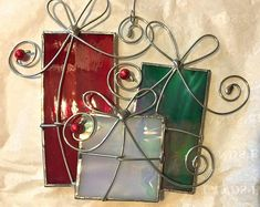 Items similar to Stained Glass Christmas Presents on Etsy Stained Glass Tattoo, Stained Glass Cookies, Stained Glass Door, Stained Glass Ornaments, Stained Glass Birds, Stained Glass Christmas, Stained Glass Suncatchers, Stained Glass Designs, Stained Glass Projects
