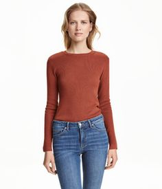 Dark gray melange. Fine-knit, cotton-blend sweater. Straight cut with long sleeves.