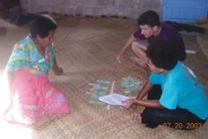 Joe Henrich and research assistant administer the Third Party Punishment Game in the village of Teci on Fiji's Yasawa Island.