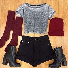 grey faded cropped tshirt, black high waisted shorts, black lace up heeled combat boots, dark red over the knee thigh high socks, and dark red beanie.