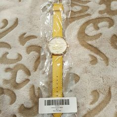 """Geneva ~ watch with yellow strap & anchor design Geneva, NWOT,  original packaging with """"Yellow Anchor Watch"""" & """"one size"""", band appears faux leather, face is white with 4 crystals representing 12, 3, 6 & 9, and a striped golden anchor. Geneva  Jewelry"""
