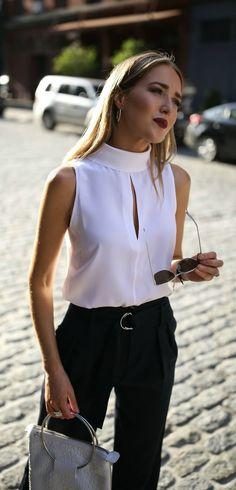 Mock Neck Blouse + Wide Leg Trousers // Ivory mock neck keyhole blouse, navy pleated wide leg trousers, white handbag, mirrored sunglasses {Frame, Banana Republic, workwear, creative office style}