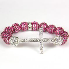 Pink, bling, & a beautiful cross...seriously my kind of bracelet. 3 things I absolutely LOVE
