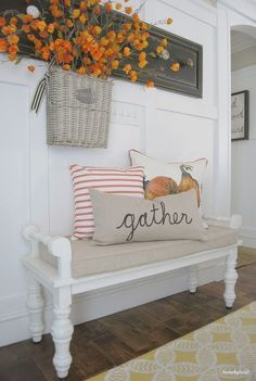Adding a pillow to a bench or chair can make all the difference. We love the fall decor in this foyer. How sweet are those orange flowers, they really pull together with the pillows. More Inspiring Farmhouse Fall Decor on Frugal Coupon Living. Fall Home Decor, Autumn Home, Diy Home Decor, Muebles Living, Foyer Decorating, Fall Decorating, Decoration Bedroom, Wall Decor, Home Decor Accessories