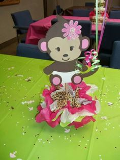 Monkey center piece for girl baby shower made from foam and tissue paper stuffed in a small glass for the base. Flower has small white pearls for the middle.