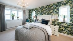 A country garden themed bedroom with a feature floral wall.