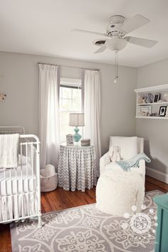 neutral nursery - double curtains - look white but grey will still block sunlight.