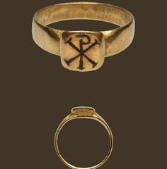 A Roman fourth-century gold ring engraved with the Chi-Rho monogram of Christ/labarum.