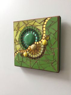 Mosaic wall art in green and yellow.