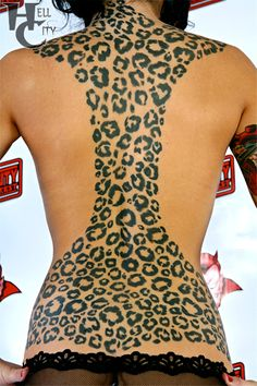 LOVE. Leopard print tattoo.  Not this much but thinking about a shoulder tat!