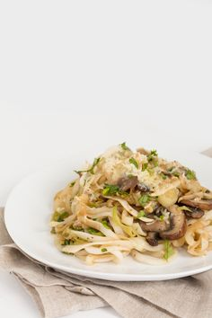 """GARLIC MUSHROOM & LEEK TURNIP """"NOODLES"""" - Spiralized! """"Garlic, mushroom sand leeks add such an earthy, savory flavor to this pasta dish that's craveable. The parmesan cheese at the end melts into the soft turnip noodles and makes this dish velvety and delicious."""""""