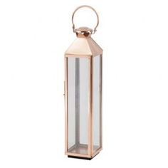 Small Rose Gold Floor Standing Lantern.  Stunning coastal inspired floor lantern in a romantic, warm rose gold finish.  Place in the entrance hall, in the dining room or on the stairs.… somewhere it will be noticed and admired!