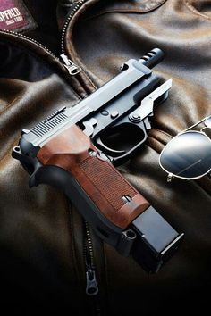 Beretta 93R- Would love to shoot one some day.