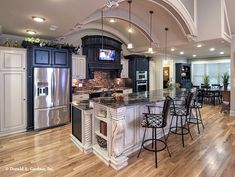 This #kitchen is perfect for entertaining with a barrel-vaulted ceiling and an #island with bar seating. The MacAllaster #838 - http://www.dongardner.com/house-plan/838/the-macallaster. #FloorPlan