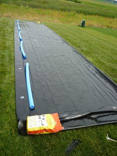 HUGE DIY slip and slide, almost like ours but I didn't think of the noodles.. Will have to do next time so we don't get all scratched up!