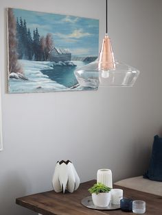 Laaka pendant lamp adds warmth to this cosy kitchen. Laaka consists of two parts:  glass shade and concrete base, which together create great contrast. Laaka is designed by Finnish designer Laura Väre.