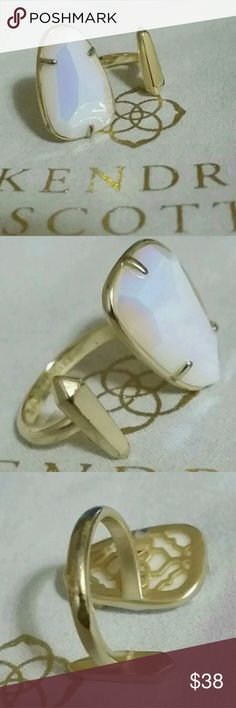 KENDRA SCOTT WHITE IRIDESCENT GOLD AUSSIE RING M/L KENDRA SCOTT AUSSIE RING  WHITE IRIDESCENT STONE  SIZE MEDIUM/LARGE ADJUSTABLE   STONE HAS SOME WEAR ON IT SEE UP CLOSE FOURTH PHOTO  SOME GOLD PLATING COMING OFF THE BACK  USED CONDITION  THE DOT NEAR THE END OF THE STONE IS A TINY NICK   CUSTOM  NO DUST BAG INCLUDED    PRICE IS FIRM NO OFFERS PLEASE Kendra Scott Jewelry Rings