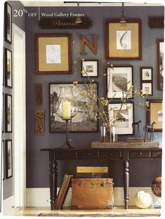Love the wall color and placement of photos and letter. Neat idea for a family room or a home office space.
