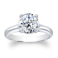 Ladies 18kt white gold engagement ring with a natural 2ct Round Brilliant White Sapphire. The Round Brilliant measures 8mm square. $625
