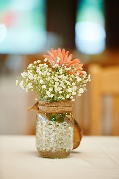 Simple flower centerpiece idea - baby's breath + Gerbera daisy in mason jar wrapped in burlap {A Photographic Memory}