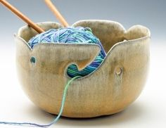 Yarn bowls!  Slipped holes feed out the yarn and punctured holes  hold the knitting needles. etroolines