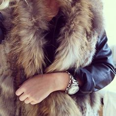 Fur vest (or fur scarf) over a leather jacket. #outfitinspiration