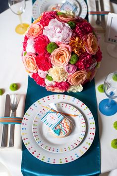 Beautiful Pomander Ball consisting of various flowers including roses, peony, and carns.