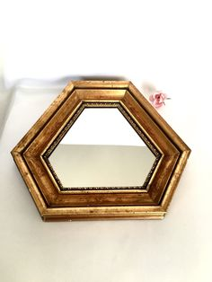 A personal favorite from my Etsy shop https://www.etsy.com/ca/listing/265964661/gold-mirror-hexagon-shaped-gold-gramed