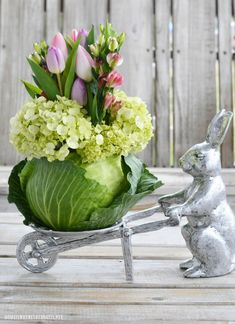 Bunny with wheelbarrow and floral cabbage arrangement DIY with tulips | ©homeiswheretheboatis.net Flower Vases, Flower Pots, Flower Arrangements, Cabbage Flowers, Green Carnation, Spring Flowering Bulbs, Hydrangea Not Blooming, Floral Tablecloth, Bouquet