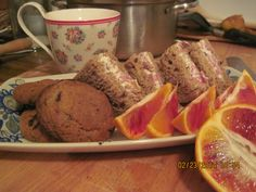 English tea. Chocolate chip cookies. Hot tea w milk. Pastrami & herb cream cheese sarnies.