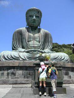 Children donating to the giant Buddha in Kamakura, Japan