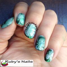 Shamrock water marble nail art for St. Patrick's Day