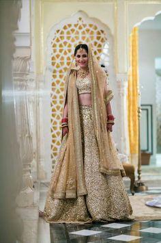 Shimmering gold lehenga. Indian bride #shaadibazaar #weddings