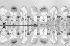 The reflections augment the geometry and architecture of Sheikh Zayed's Grand Mosque in Abu Dhabi.
