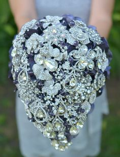 Cascading teardrop brooch bouquet -- deposit on a made-to-order bridal bouquet. $300.00, via Etsy.