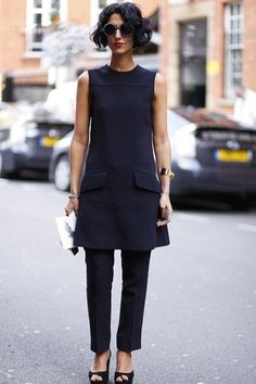# - Rule of 3 - Yasmin Sewell in a black shift dress worn over skinny suit pants Style London Fashion Week Fall women's fashion and street style. Trend Fashion, Look Fashion, Womens Fashion, Fashion Black, Mature Fashion, Fashion Weeks, Petite Fashion, Milan Fashion, Dress Over Pants