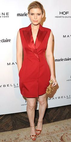 KATE MARA The actress adds some color to the Marie Claire party in a bold Dior tuxedo vest dress, which she pairs with a metallic gold clutch and coordinating shoes.